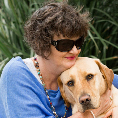 Photo of Nina Smith with her Guide Dog Nixon